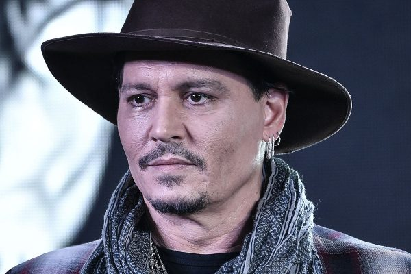 Johnny Depp flashes cowboy-look to glam up 'Master Carnival' during first Hainan International Film Festival